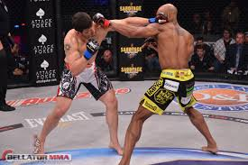 Trevor Carlson (left) lost via submission round 2 to Linton Vassell (right)
