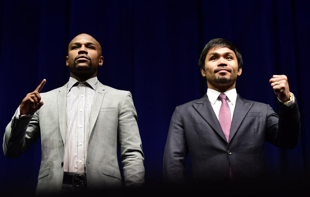 Boxers Manny Pacquiao (R) from the Philippines and Floyd Mayweather from the US gesture while posing during a press conference on March 11, 2015 in Los Angeles, California, to launch the countdown to their May 2, 2015 super-fight in Las Vegas. AFP PHOTO/ FREDERIC J. BROWN        (Photo credit should read FREDERIC J. BROWN/AFP/Getty Images)