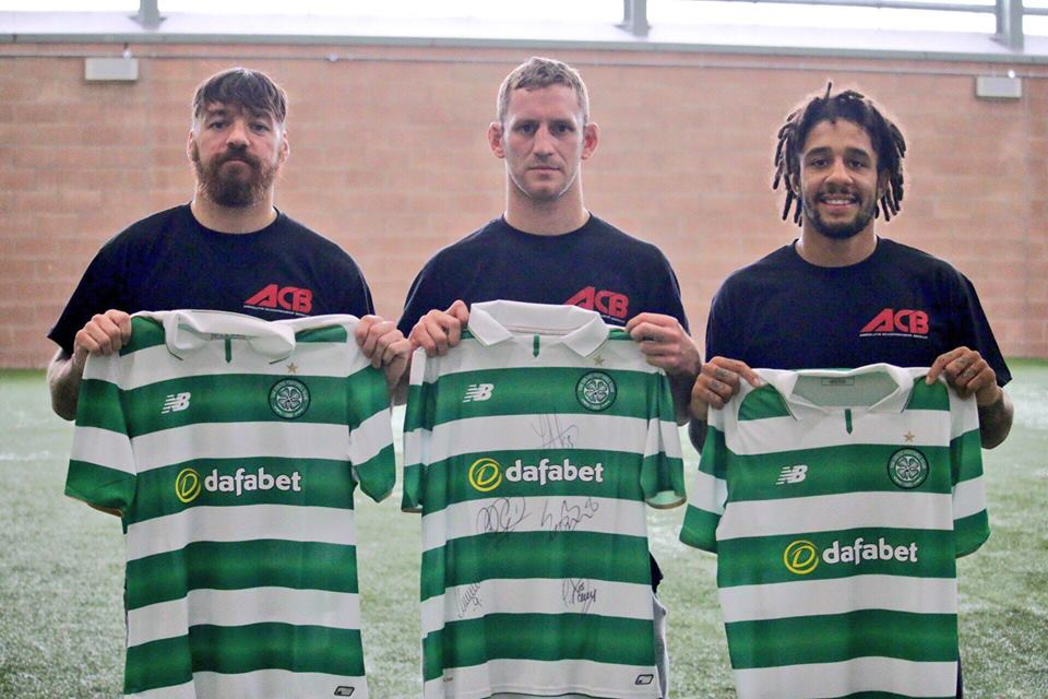 celtic-fighters-holding-jerseys