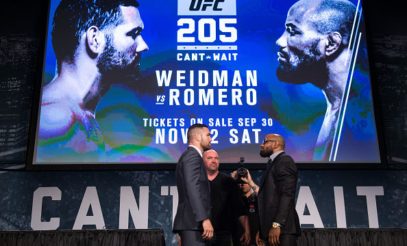 NEW YORK, NY - SEPTEMBER 27: (L-R) Chris Weidman and Yoel Romero shake hands face-off during the UFC 205 press event at Madison Square Garden on September 27, 2016 in New York City. (Photo by Brandon Magnus/Zuffa LLC/Zuffa LLC via Getty Images)